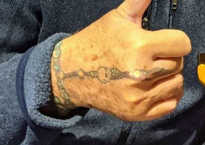 Roger hand tattoo