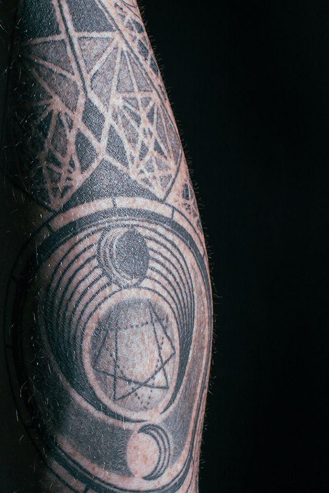 Roger inner arm tattoo