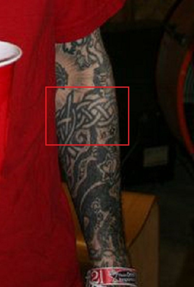 left arm of oliver tattoo peck