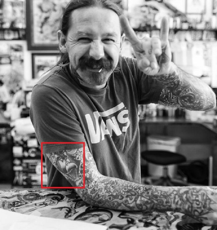 right arm tattoo of oliver peck