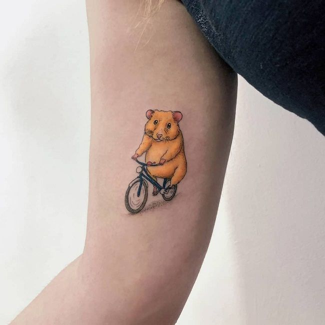 A Hamster riding a bicycle Tattoo