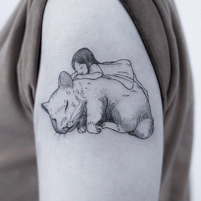 A girl sleeping on a Hamster Tattoo