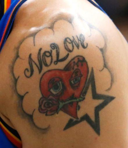 Abdel Nader no love tattoo