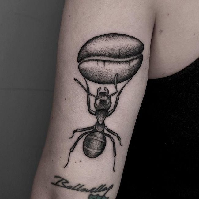 An Ant carrying a Coffee Bean Tattoo