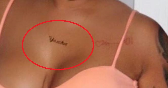 Ariana cleavage tattoo