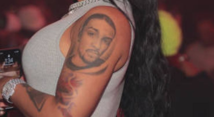Ariana left bicep tattoo