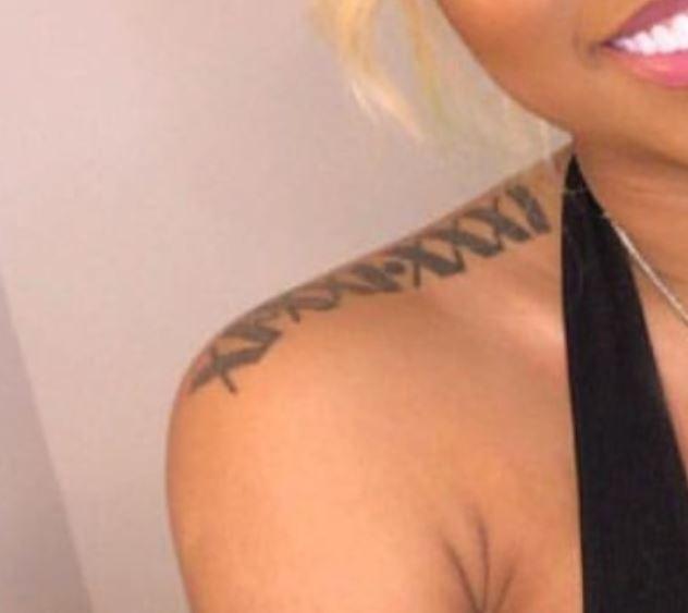 Ariana roman numerals tattoo