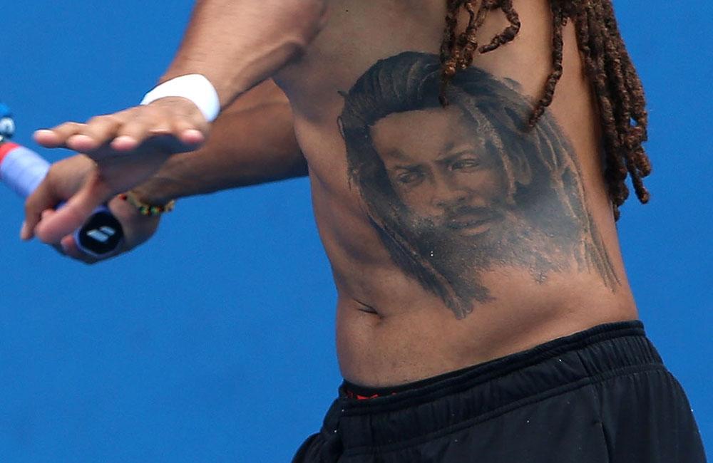 Dustin stomach portrait tattoo