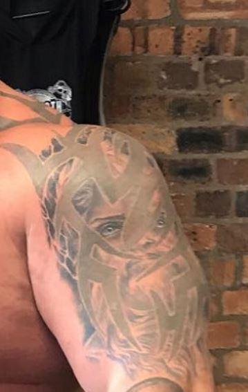 Eddie tribal cover up tattoo