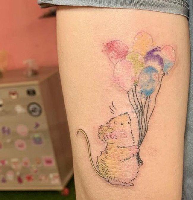 Hamster holding balloons Tattoo