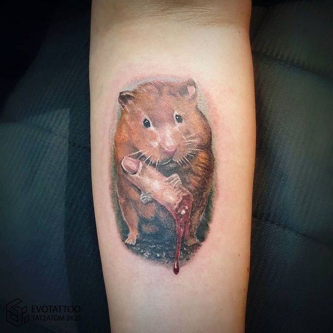 Hamster with a finger Tattoo