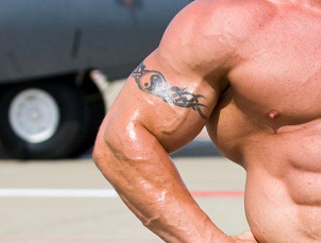 Mariusz arm band tattoo