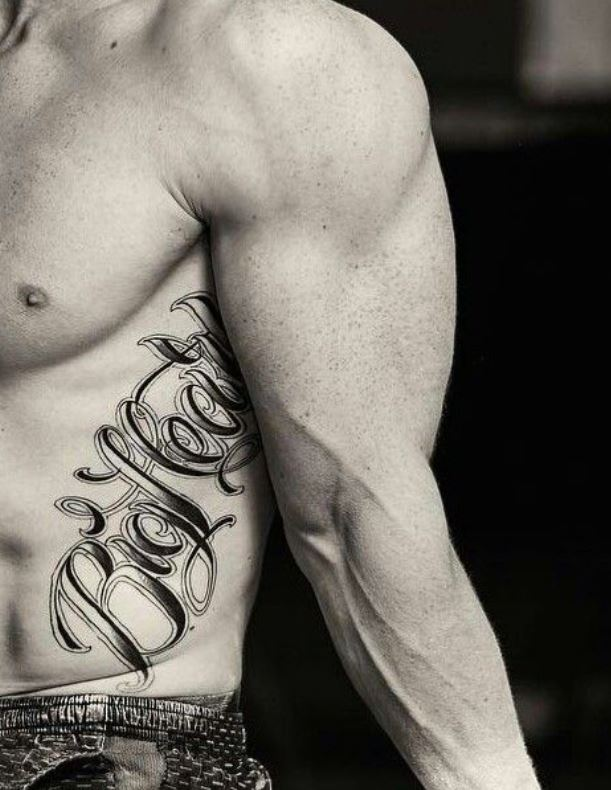 Nile ribcage writing tattoo