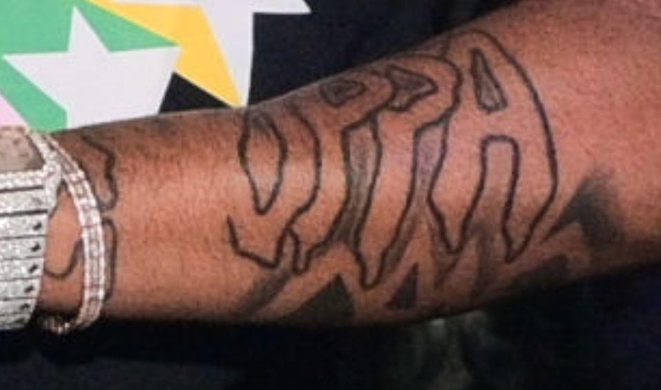 Pooh left arm design tattoo