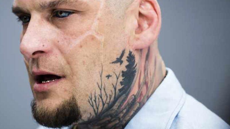 Popek left chin tattoo