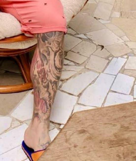 Popek left leg tattoo