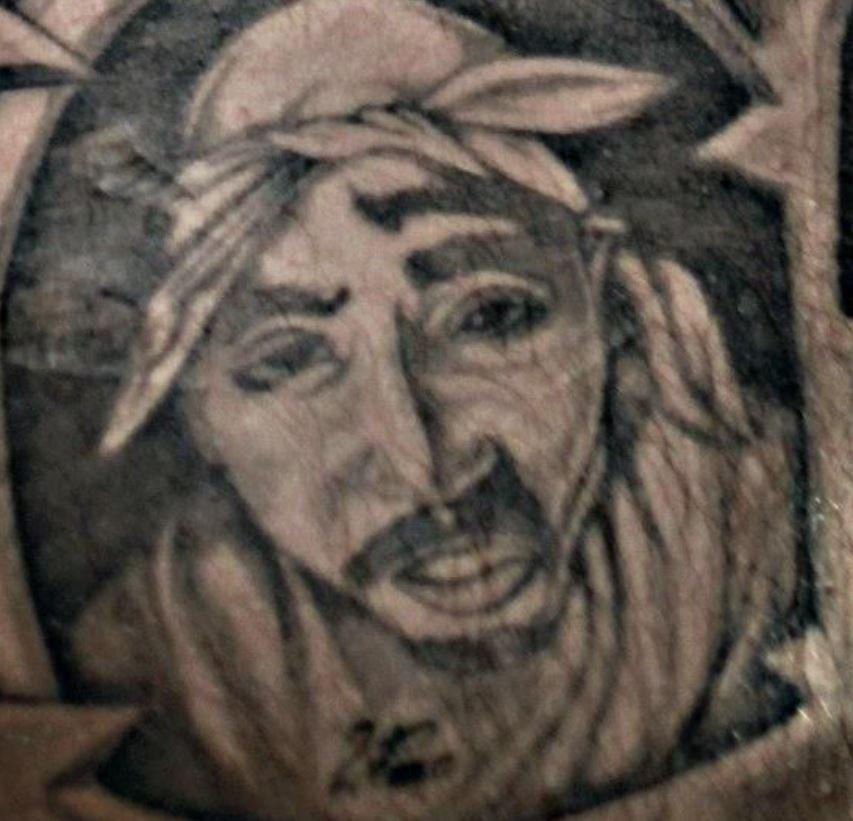 Popek right pec tattoo