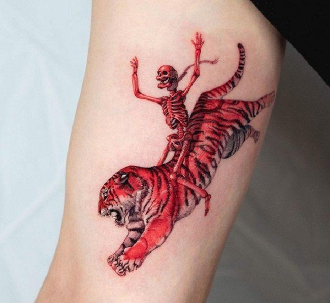 'Skull sitting on a Tiger' Tattoo