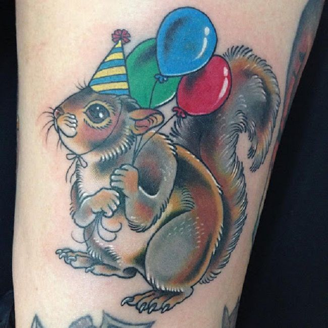 Squirrel holding balloons Tattoo