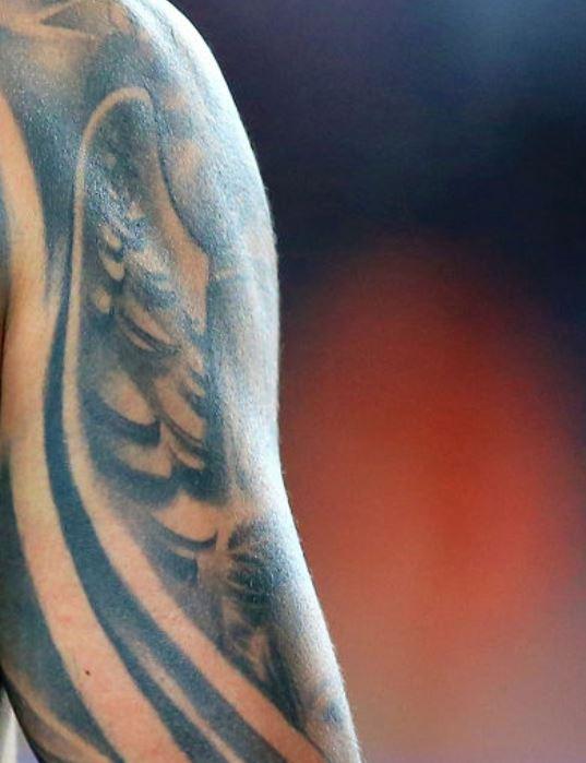 Carlos angel wings tattoo