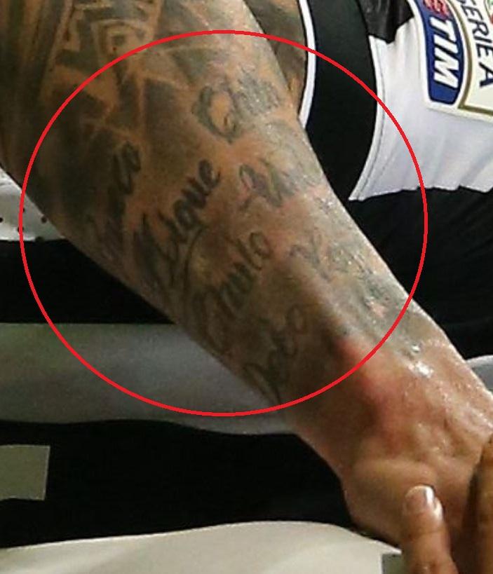 Carlos writing tattoo