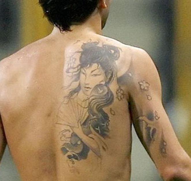 Deca tribal woman tattoo