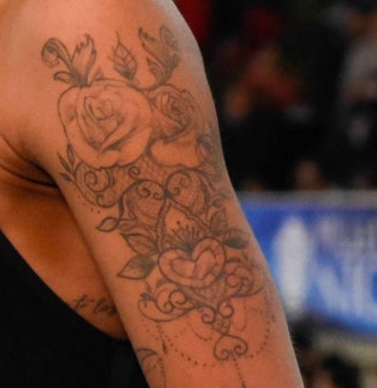 Fantine left bicep tattoo
