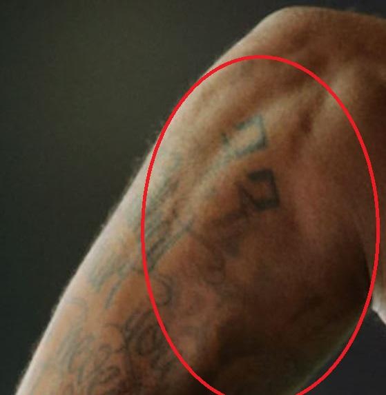 Glen number on arm tattoo
