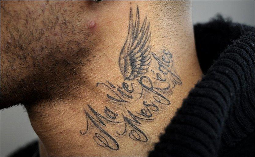 John neck writing tattoo