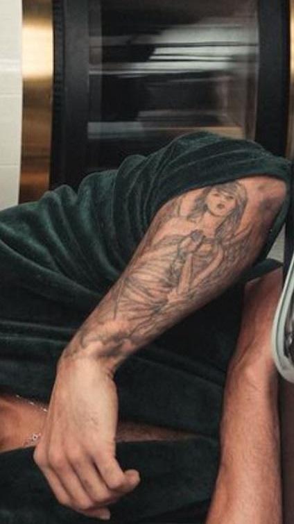 John portrait on left forearm