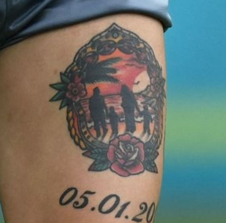 Marek left thigh tattoo