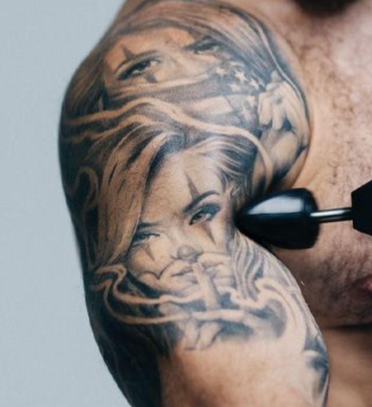 Mat portraits on shoulder tattoo