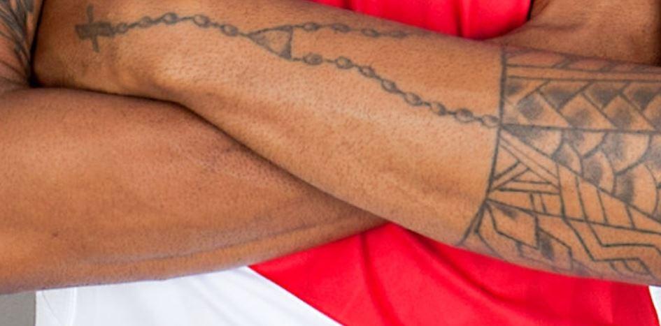 Naldo rosary beads and cross pendant tattoo