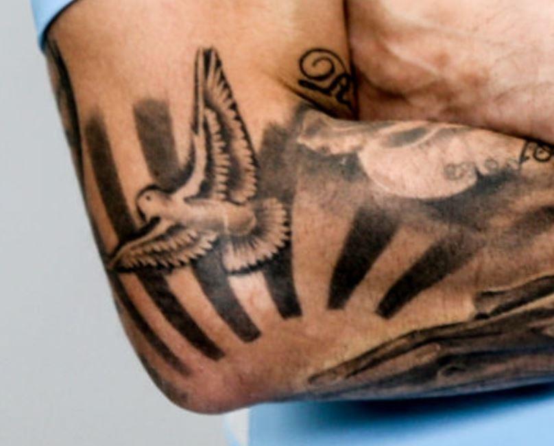 Nicolas flying swallow tattoo