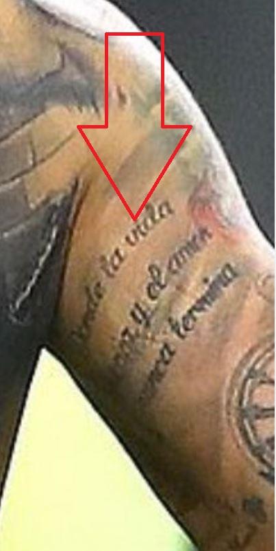 Nicolas writing on right upper arm tattoo