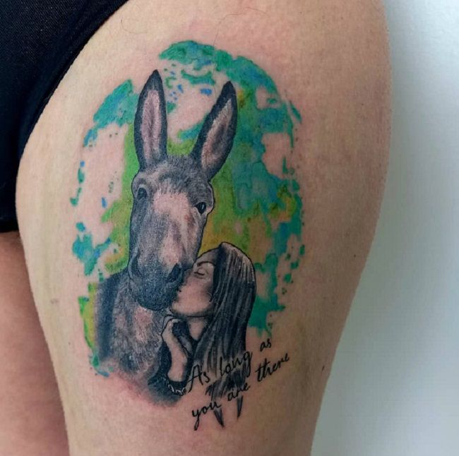 'A girl Kissing a Donkey' Tattoo