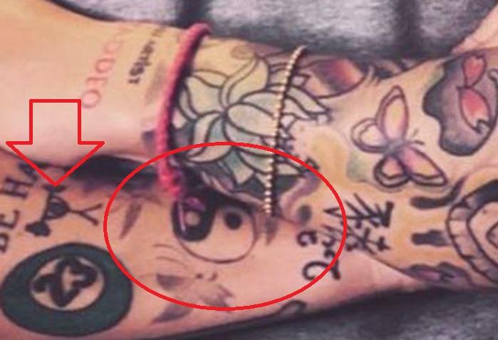 Alessandro pokemon ball tattoo