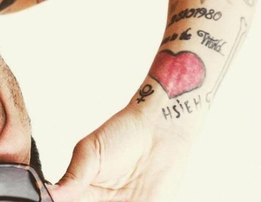 Alessandro red heart tattoo