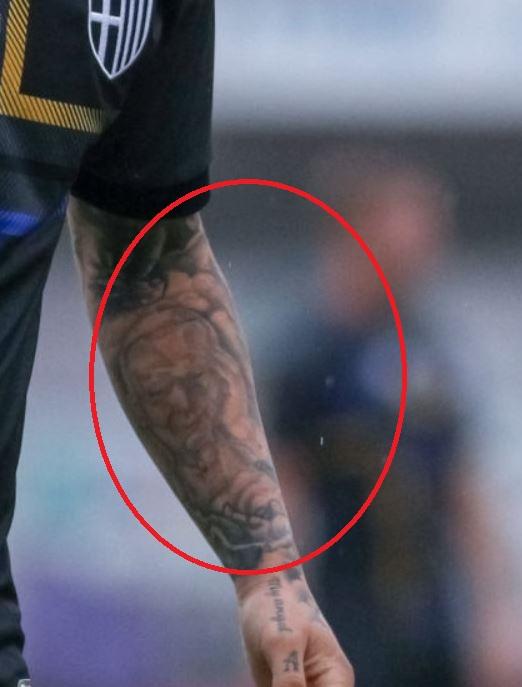 Amato left arm portrait tattoo
