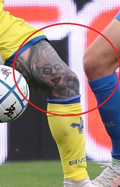 Amato left knee face tattoo