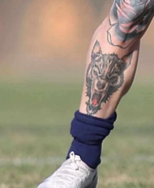 Amato right leg tattoo