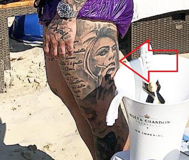 Amato thigh tattoo