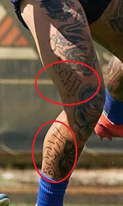 Amato words on leg tattoo
