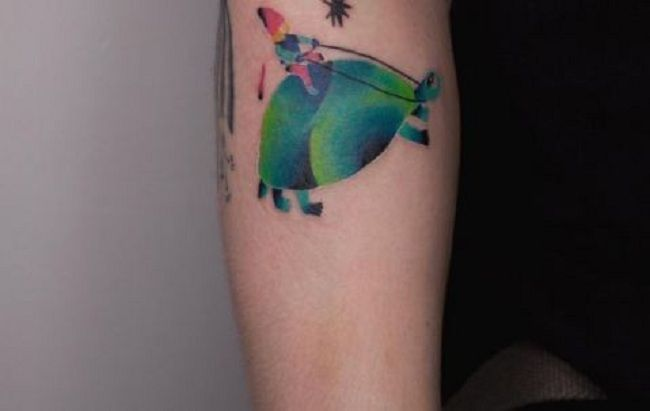 'Boy riding a Turtle' Tattoo