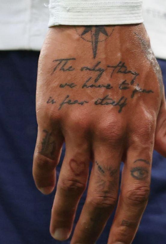 Dele writing on hand tattoo