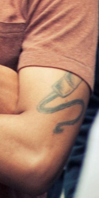 Kid Cudi left bicep tattoo