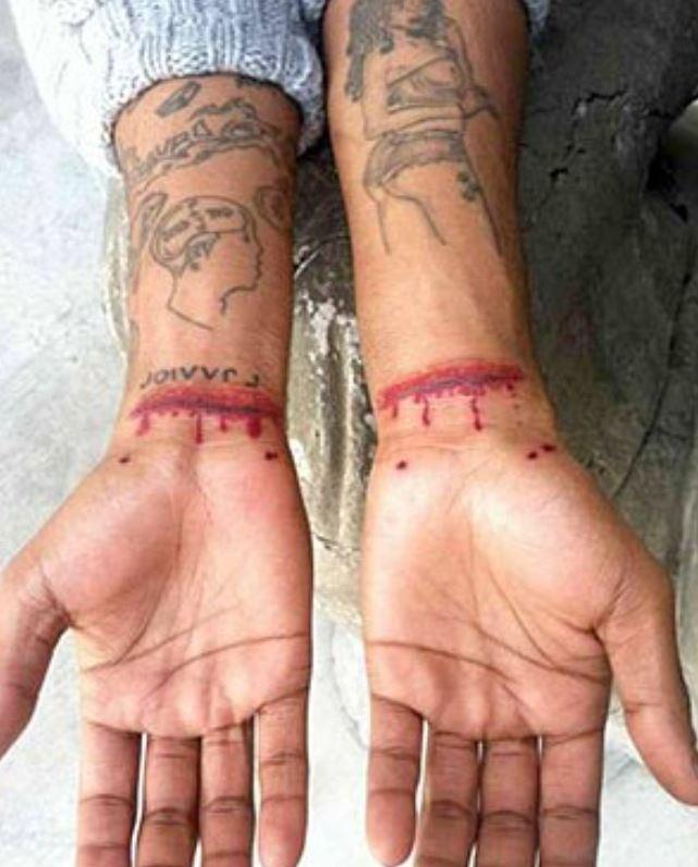 Kid Cudi wrist tattoos