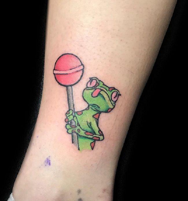 'Lizard holding a Lolipop' Tattoo
