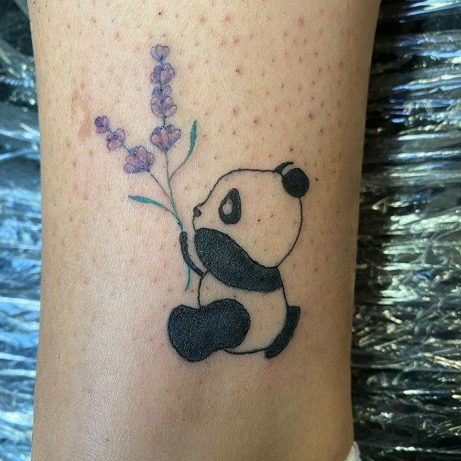 'Panda holding a lavender flower' Tattoo