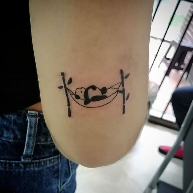 'Panda resting on Rope Hammock Swing' Tattoo